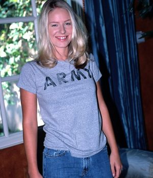 Standing Up In Blue Jeans And T-Shirt